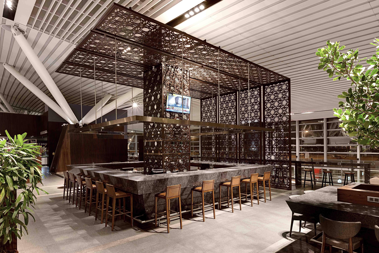 Plaza Premium Lounge Domestic Integrates Living Green Walls Custom Fret Cut Timber Panels And Traditional Doza Street Market Carts